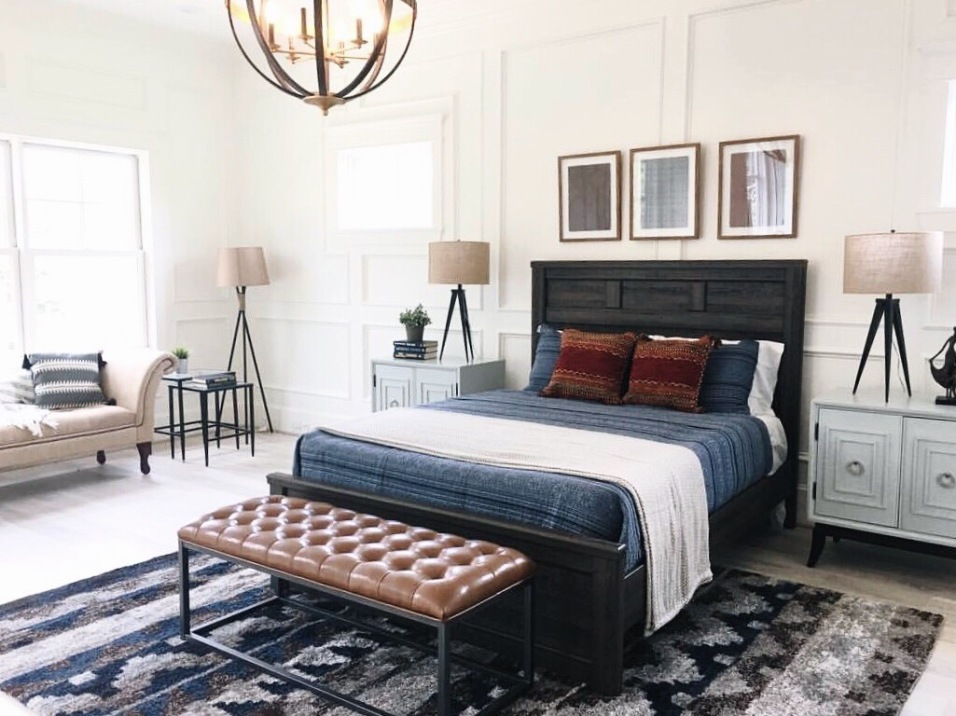 A blend of rusticn and contemporary design compketes this master bedroom
